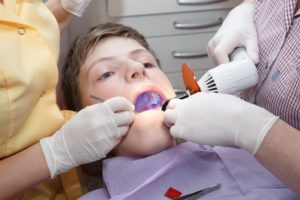 little boy in dentist chair